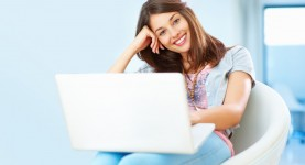 woman with an attractive smile using laptop